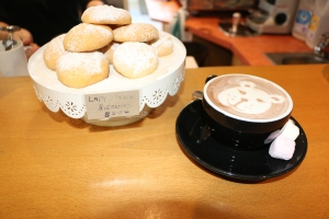 Seriously sweet - enjoy some latte art with a Lady Alice biscuit.