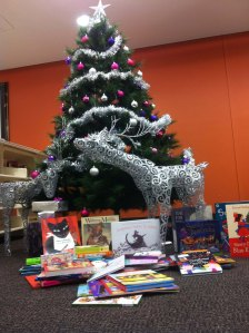 The books our patrons donated at the base of the Tea Tree Gully Library's Christmas tree!