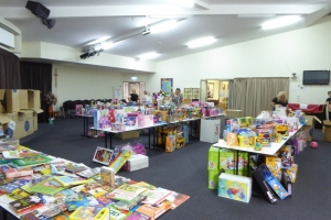 A room full of toys for kids this Christmas....the donated books are on the left