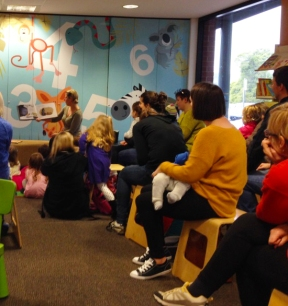 Natalie reading to the children at Story Time!