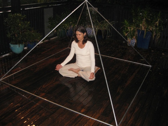 Sitting under a pyramid
