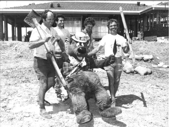 Humphrey Bear and builders at the 1984 Fairmont Pacific Telethon House in Redwood Park